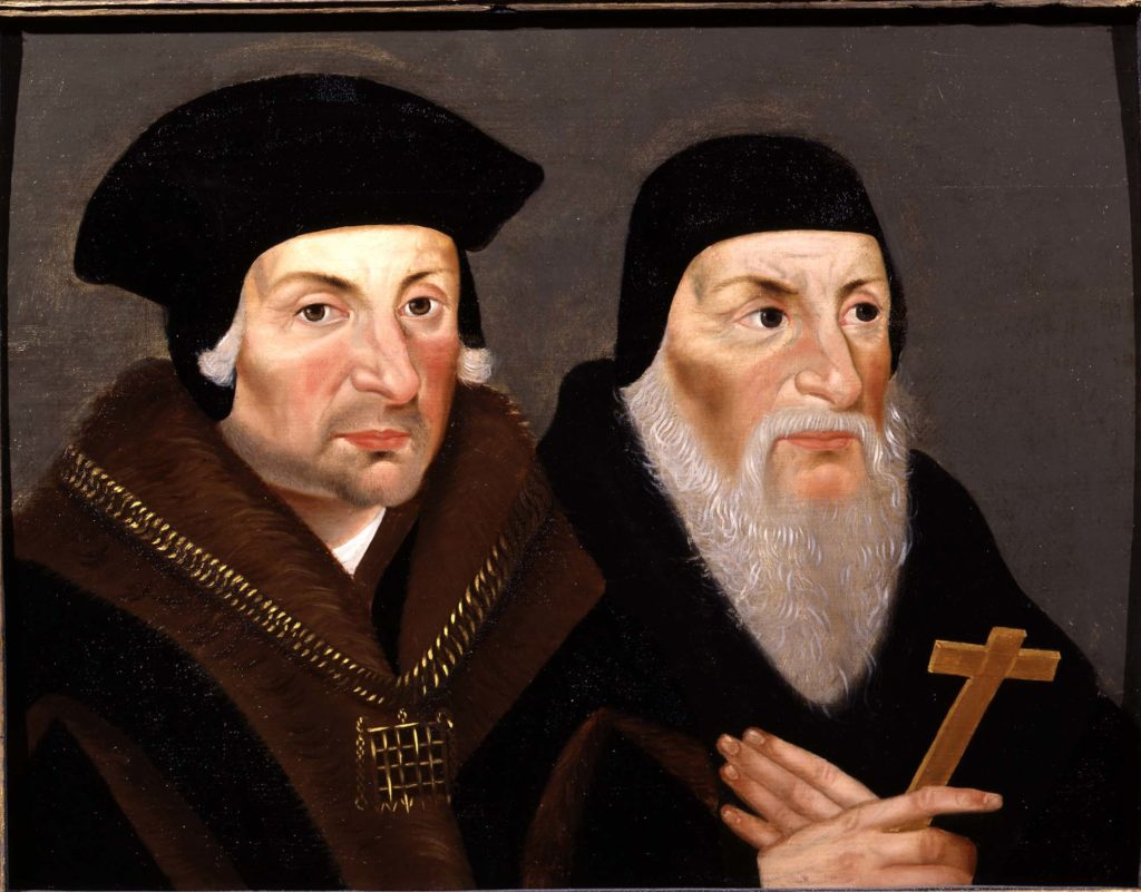 a duo portriat of two Tudor men in dark clothes and skulls caps, one of them has along grey beard and holds a cross