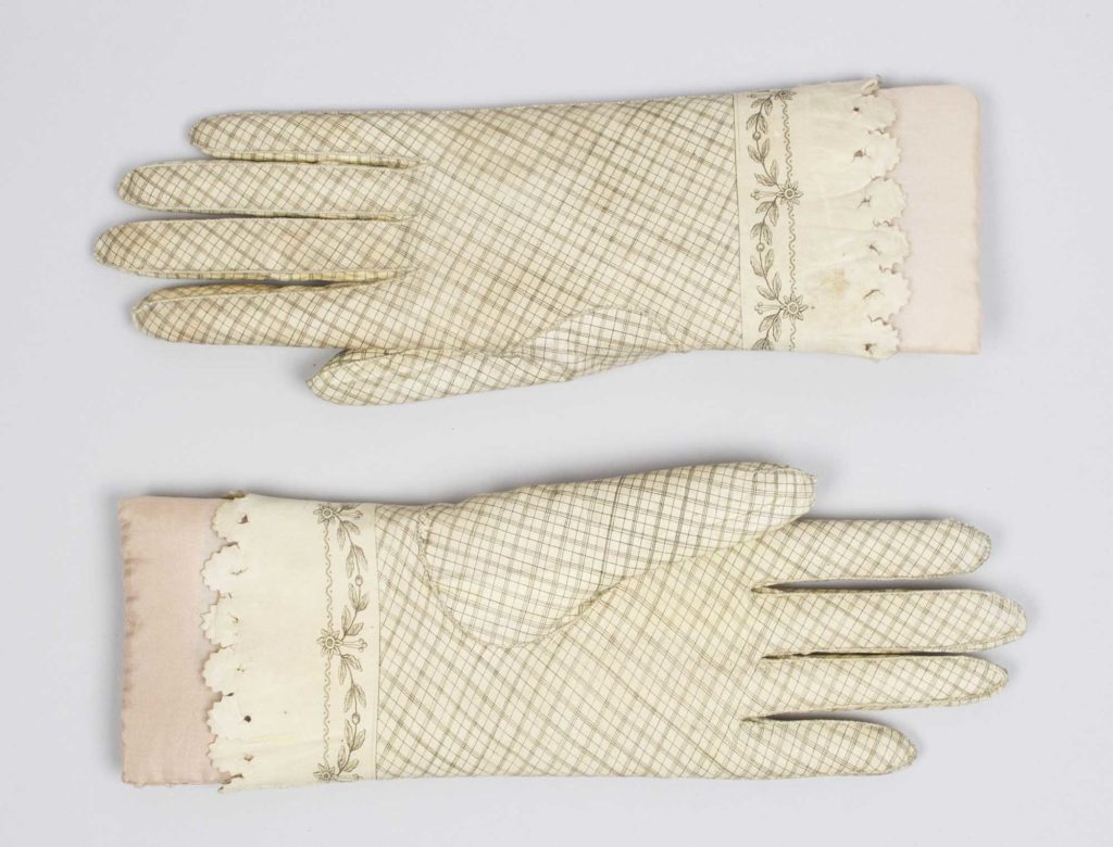 a pair of cream leather gloves