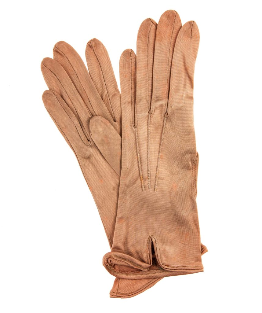 a pair of tan leather gloves