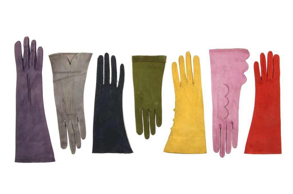 a photo of a group of brightly coloured suede gloves
