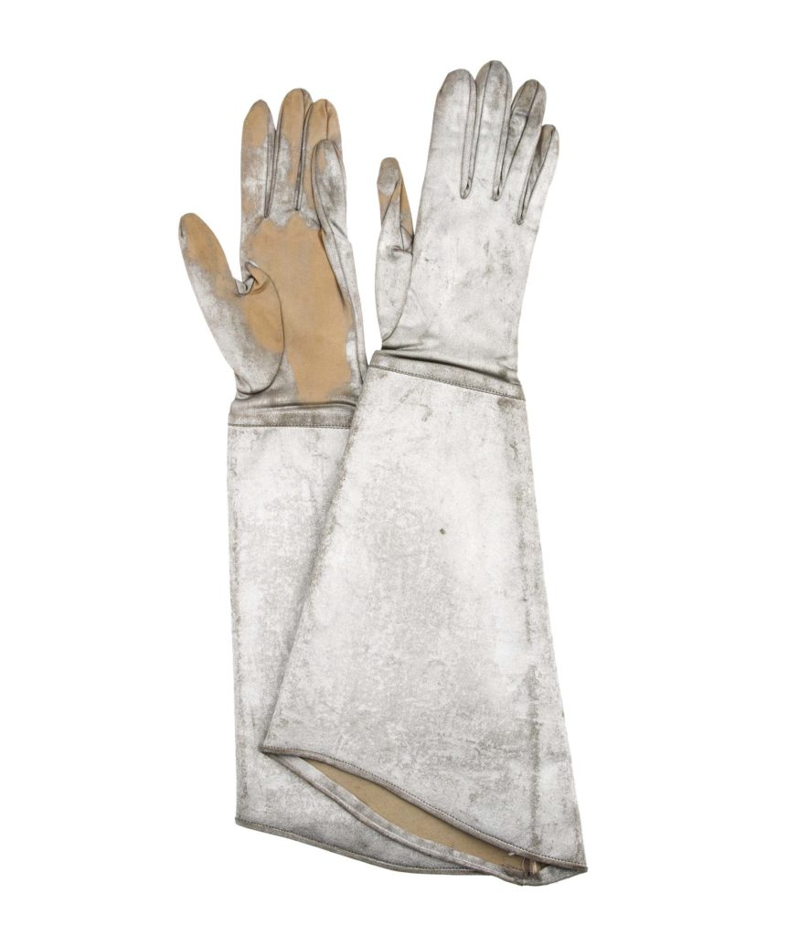 a pair of wery worn long cuffed white gauntlet gloves