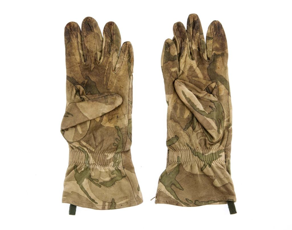 a pair of padded gloves in camouflage material
