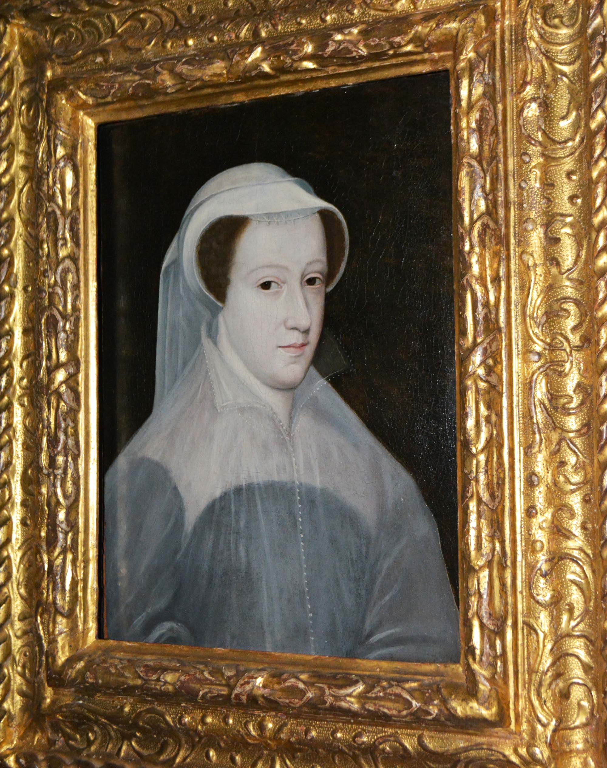 a painted Tudor portrait of Mary Queen of Scots in gilt frame