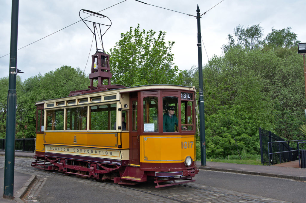 photograph of orange and red tram