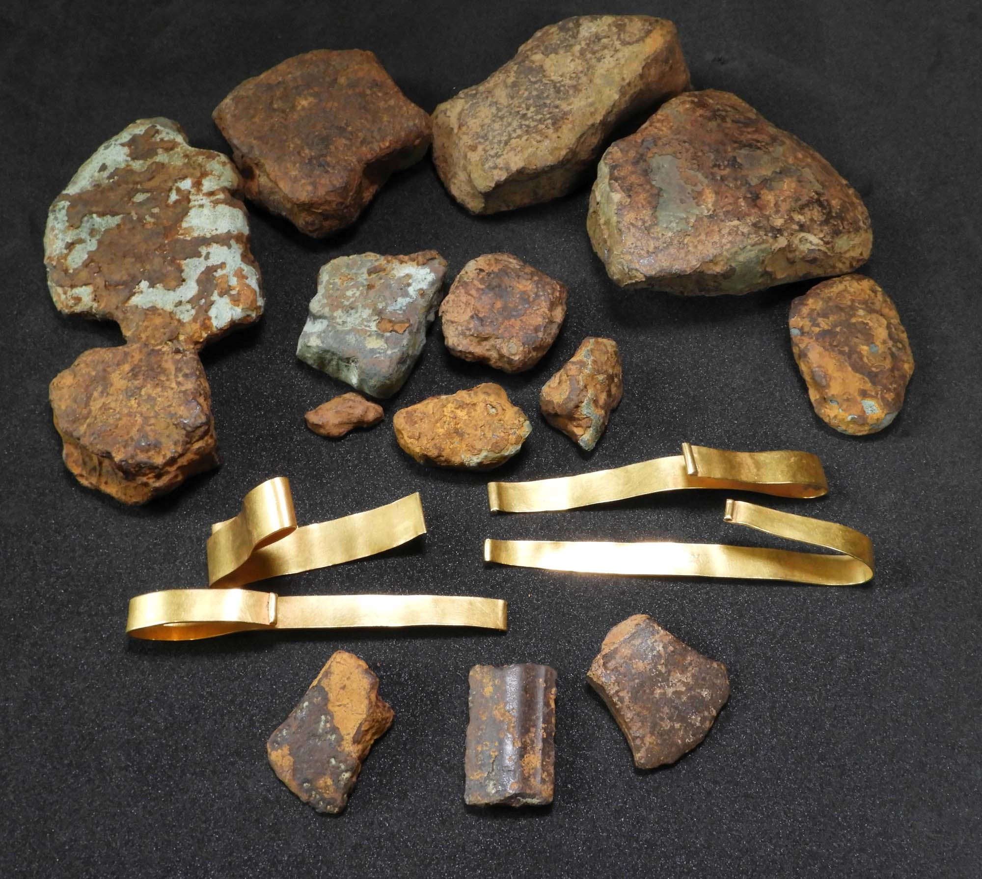 a photo of a grouping of gold and bronze objects