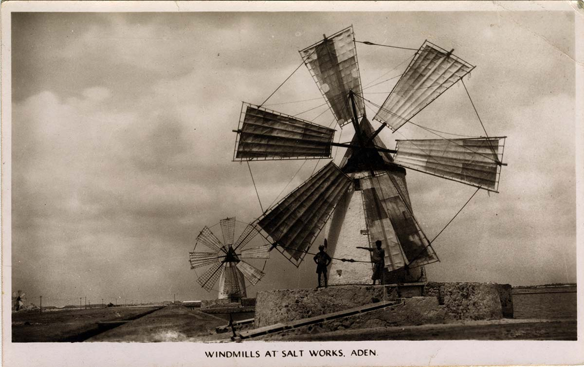 a black and white postcard with two windmills