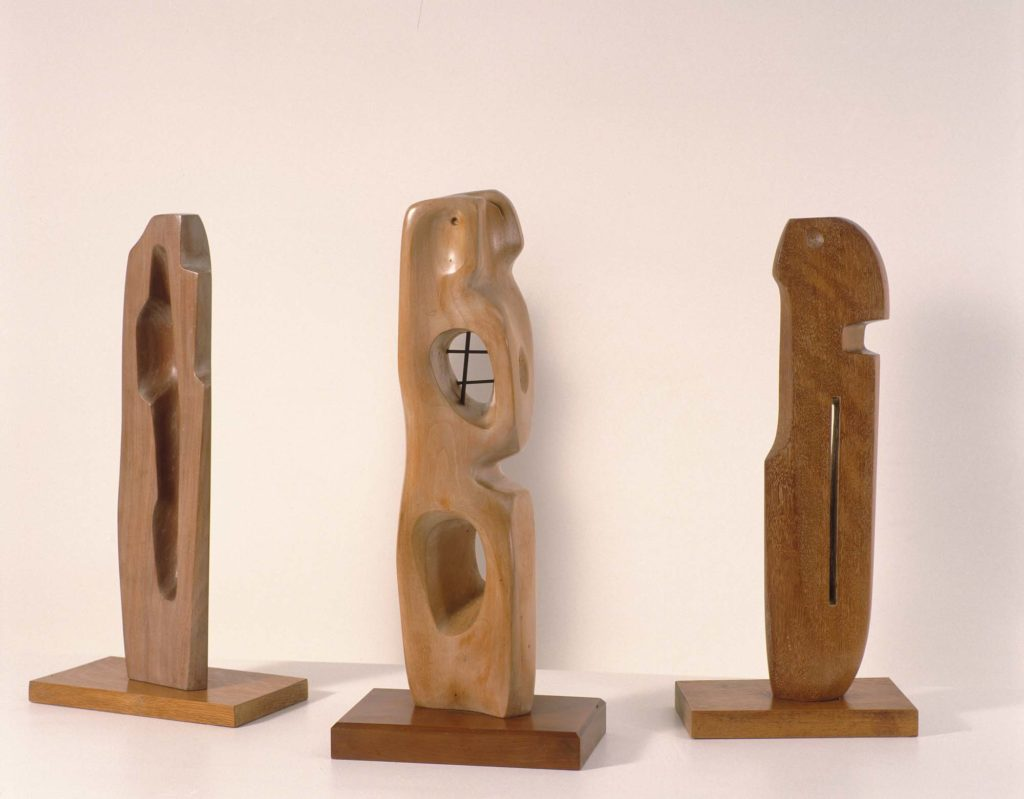 a photo showing three carved wood figures