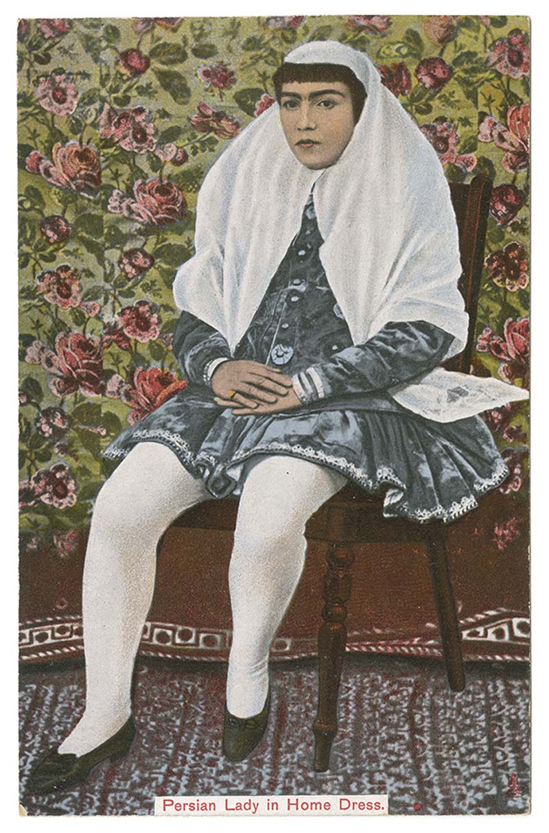 a colourised photo of a woman wearing a long flowing persian/arab style headdress, smock skirt and white tights