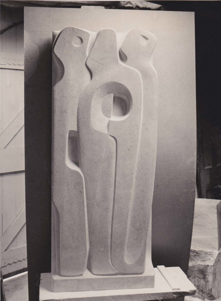 a black and white frm of relied sculpture showing three human forms