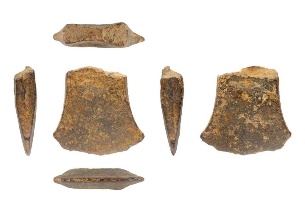 a photo of a bronze axe blade fragment seen from different angles