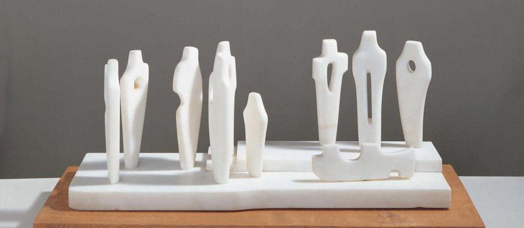 a group maquette of white figures