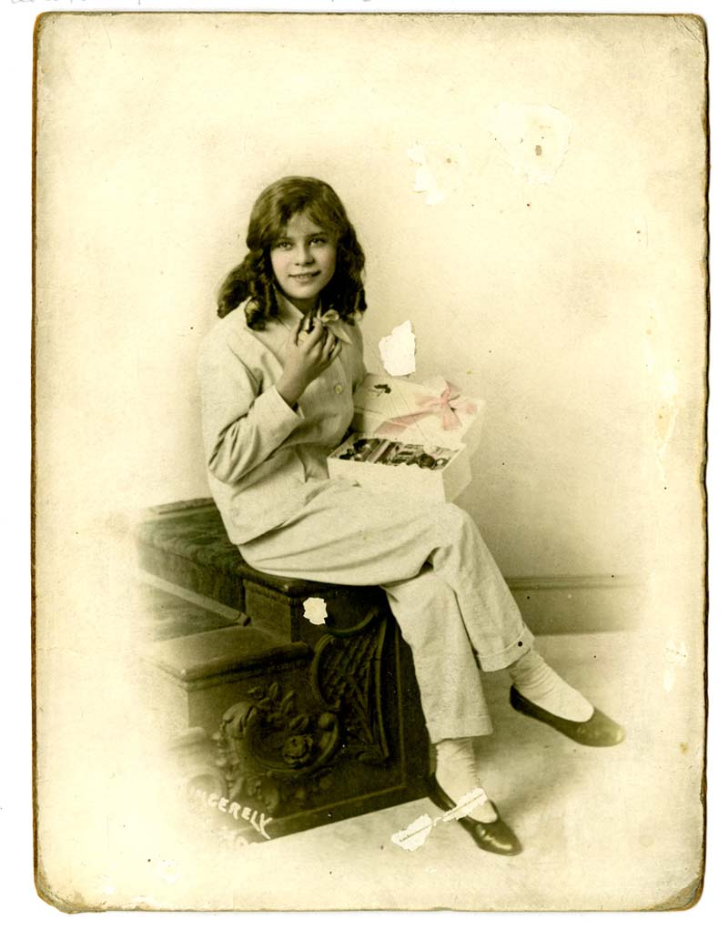a a studio photo of a teenage girl in theatrical Pierrot style suit