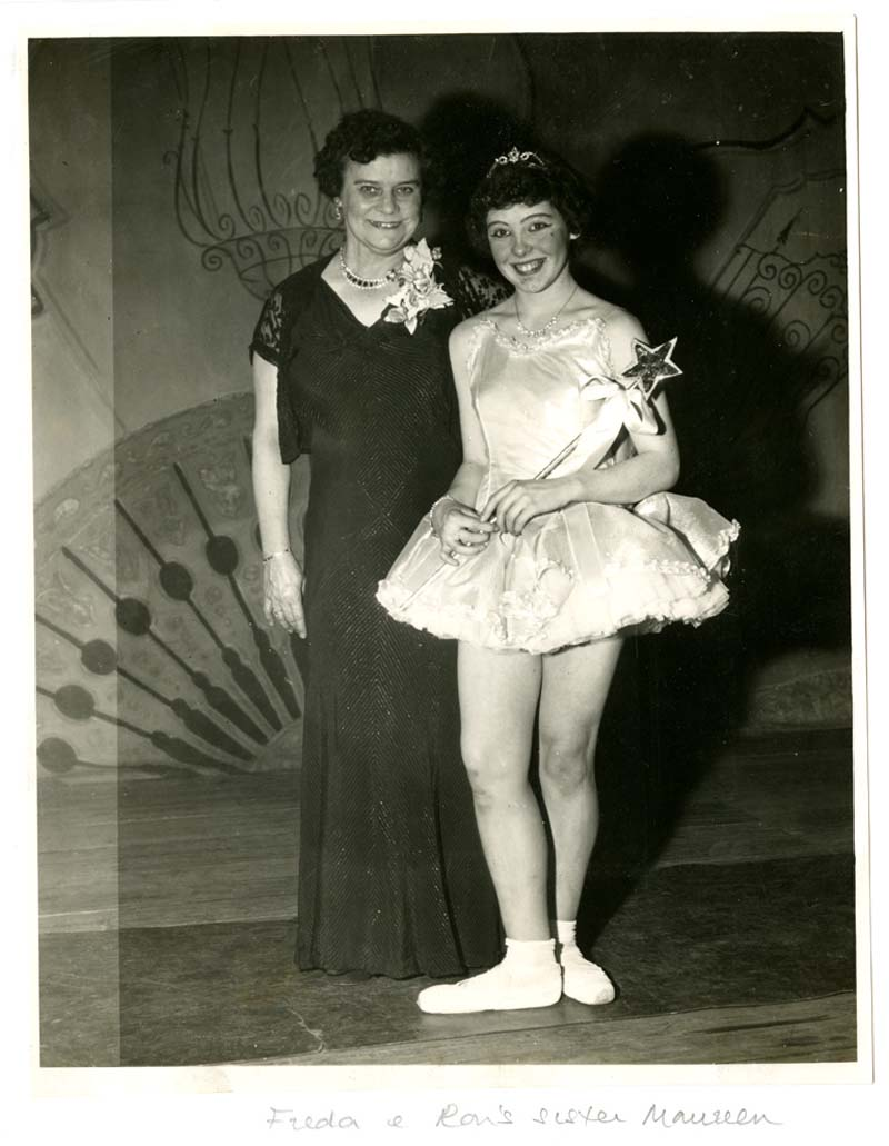 a photo of a woman with a young girl in a dancer's tutu