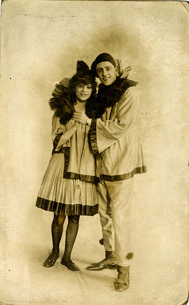 a photo of a young man and woman in Pierrot costumes