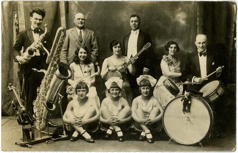 an old photo of a concert party with men and women of all ages