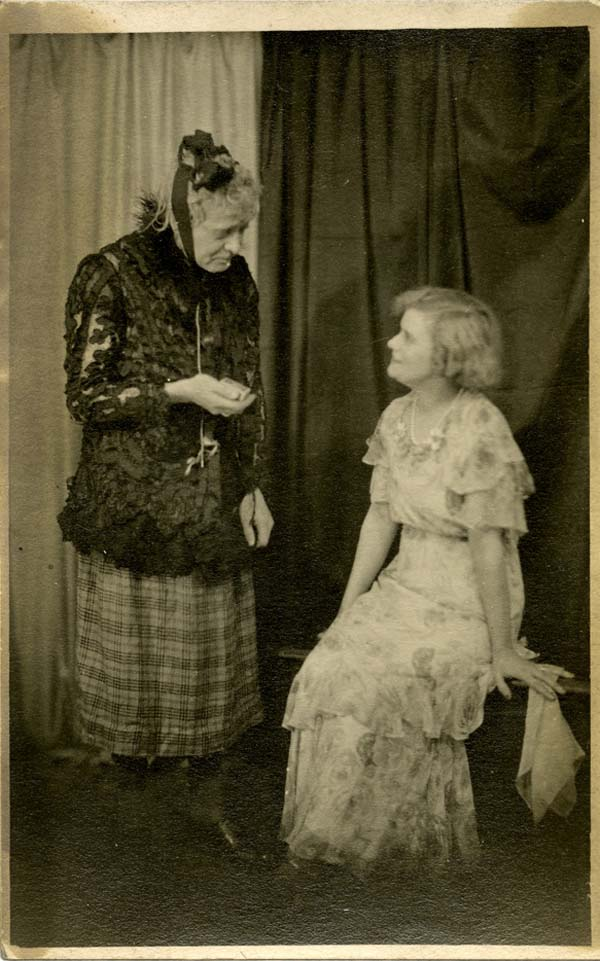 a photo of a man in drag with a young woman