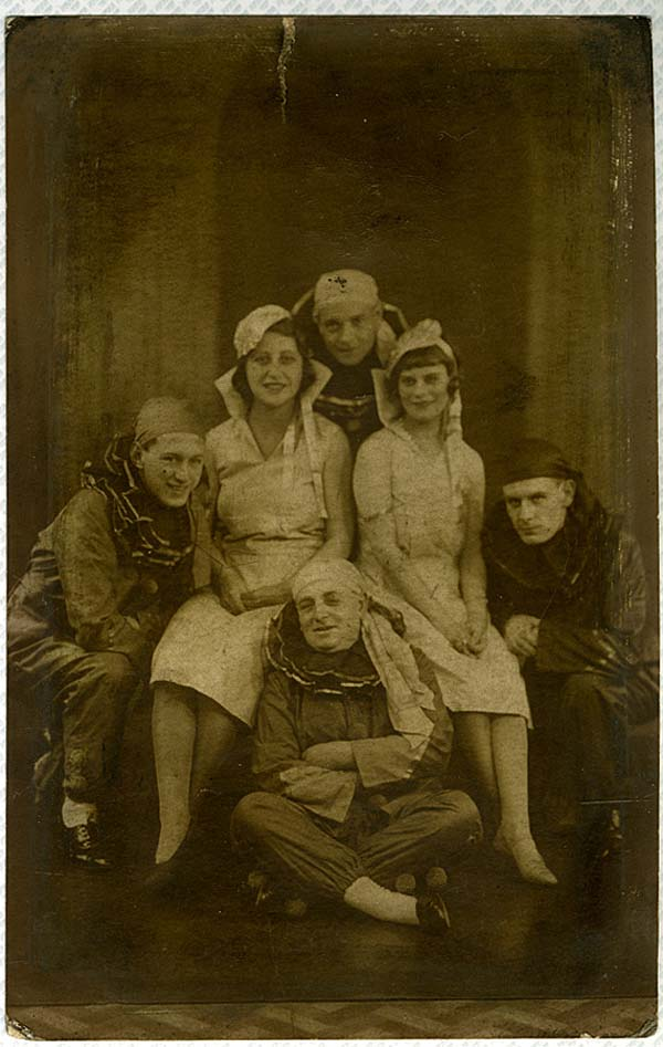 a photo of a group of men in Pierrot outfits and women in a group pose