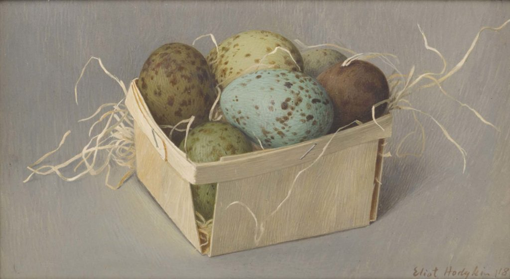 a painting of yellow, blue and borwn mottled eggs in a box filled with straw