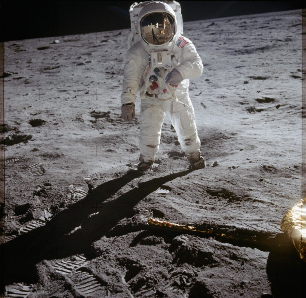 photograph of astronaut walking on the moon