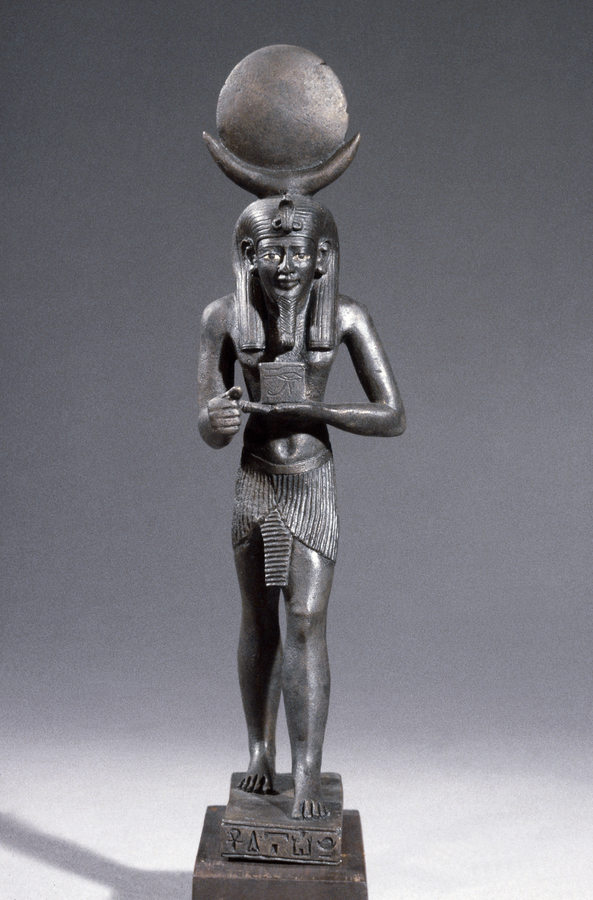 photograph of figurine of deity with large orb on their head