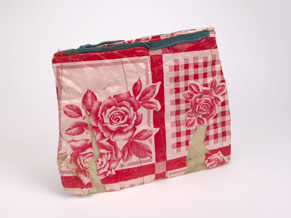 photograph of plastic wash bag with red and white floral pattern