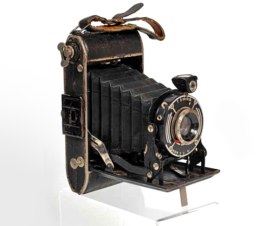 photograph of old-fashioned bellows camera with black leather casing