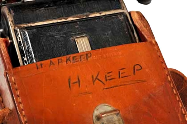 close up photograph of camera case with name 'H Keep' written on