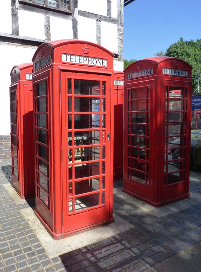 a photo of four telephone boxes