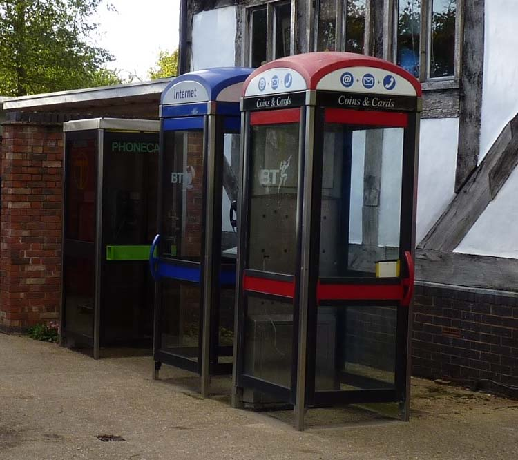 a photo of three modern telephone boxes in a line