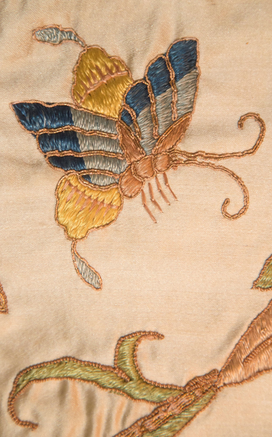 embroidered butterfly on sheet of fabric