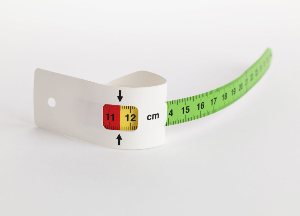 photograph of tape measure with numbers in red, yellow and green segments