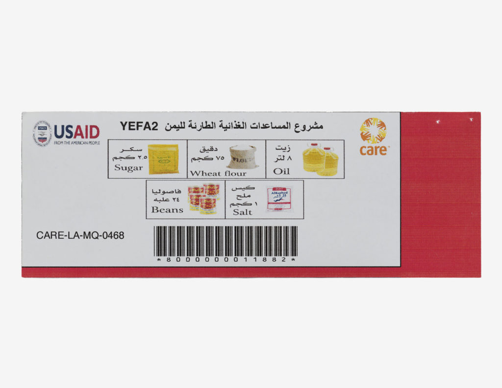 photograph of food voucher with barcode and pictures of sugar, flour, oil, beans and salt with western and arabic text