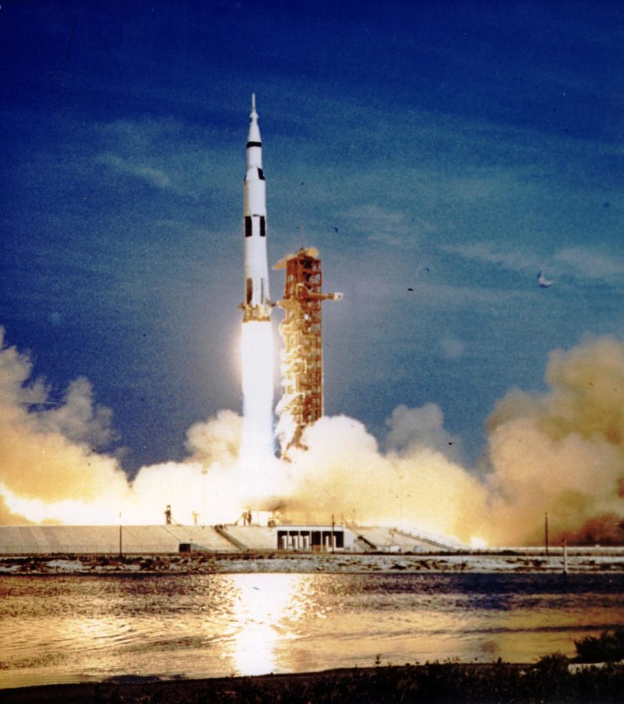 photograph of space rocket leaving launch tower