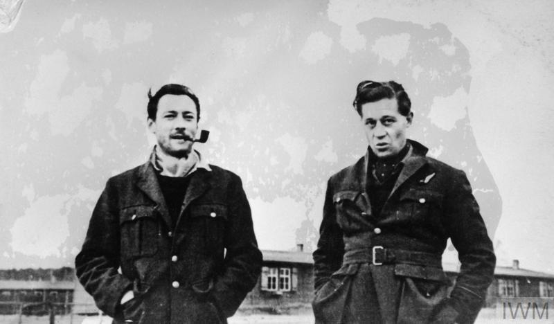 black and white photograph of two men in heavy woollen jackets