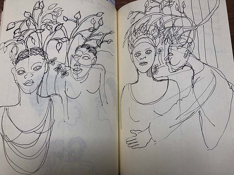 an open sketchbook showing a group of huddled figures