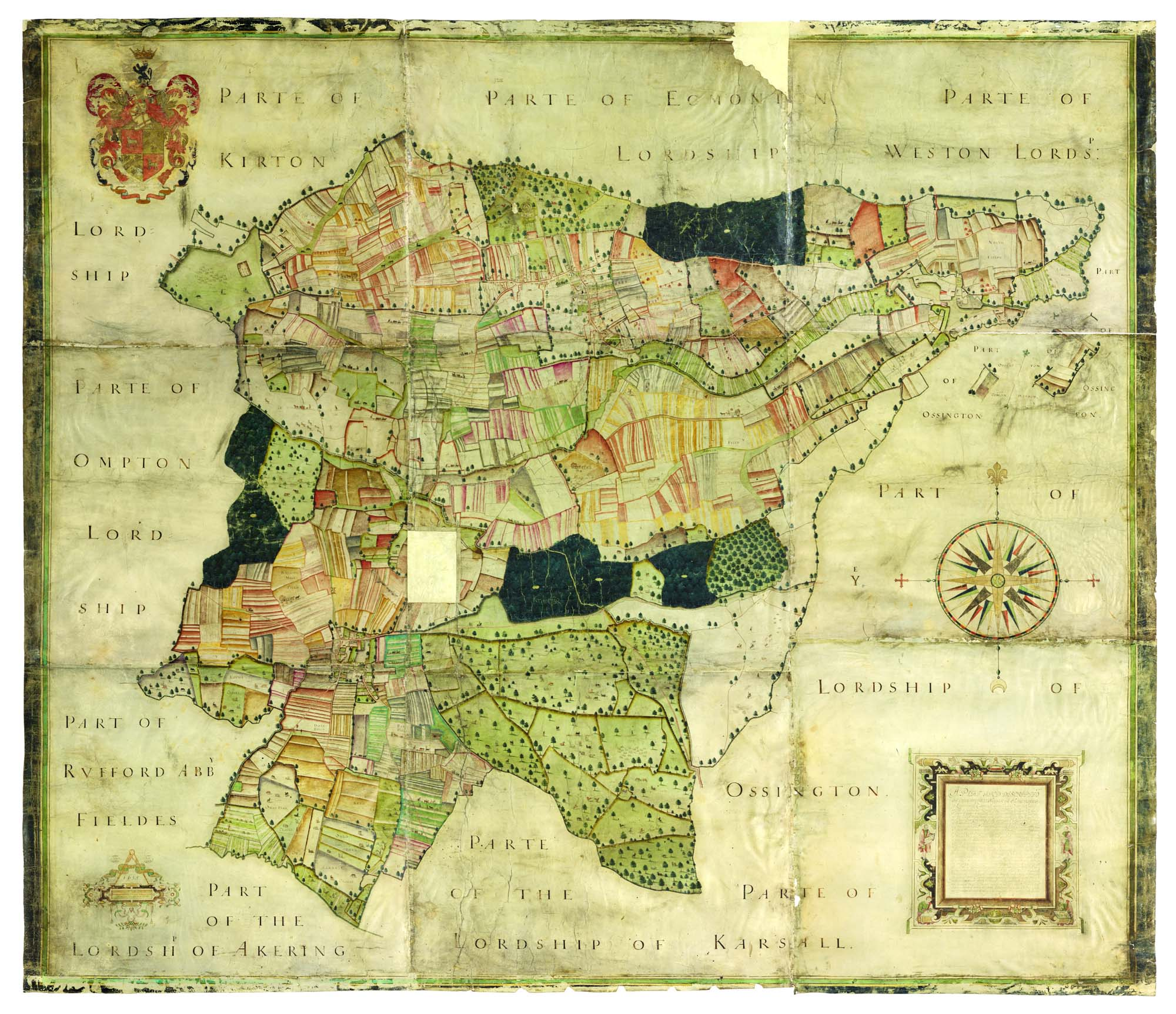 photo of an old map showing a county with filed boundaries, medieval figures and other quaint details