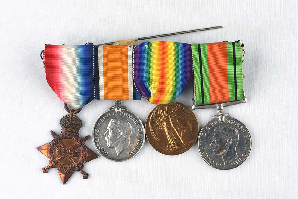 a photo of a sert of three WWI service medals and a World War Two defence medal