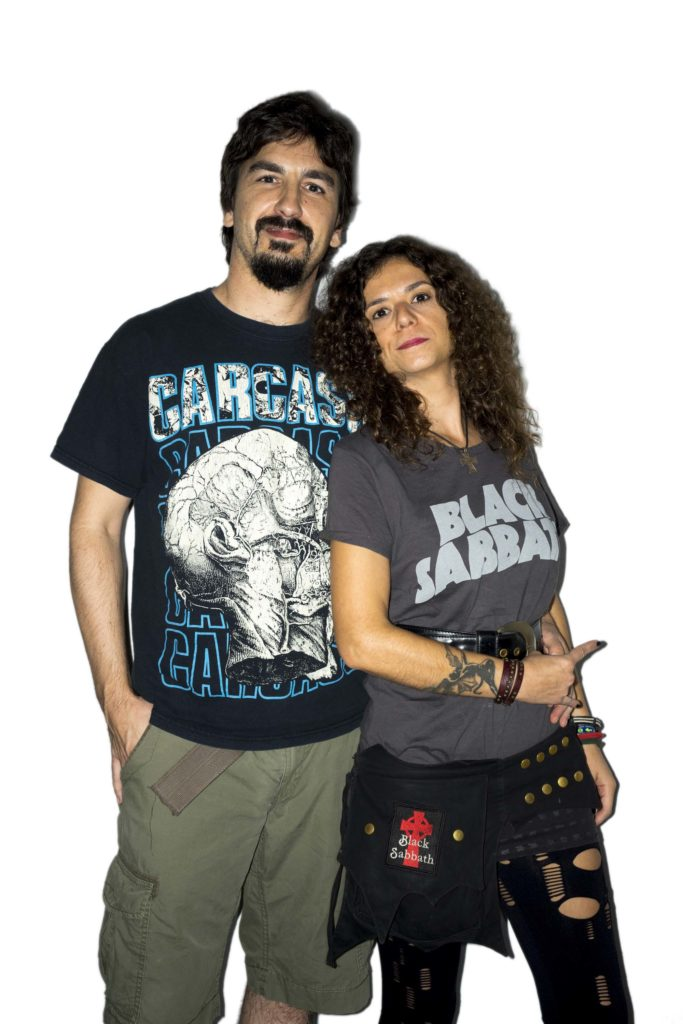 a photo of a middle aged male and female couple in heavy metal t shirts