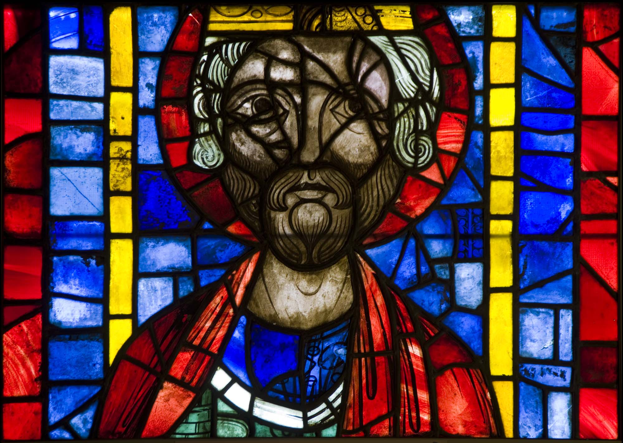 a stained glass window showing a medieval king