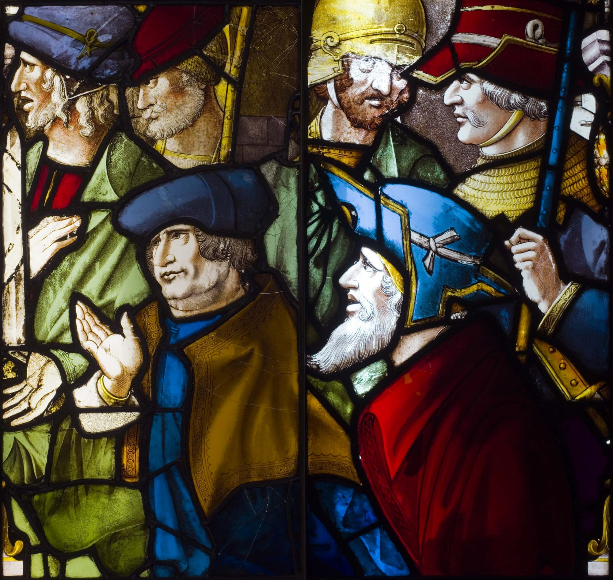 a photo of a large stained glass window with a group of medieval men in hats