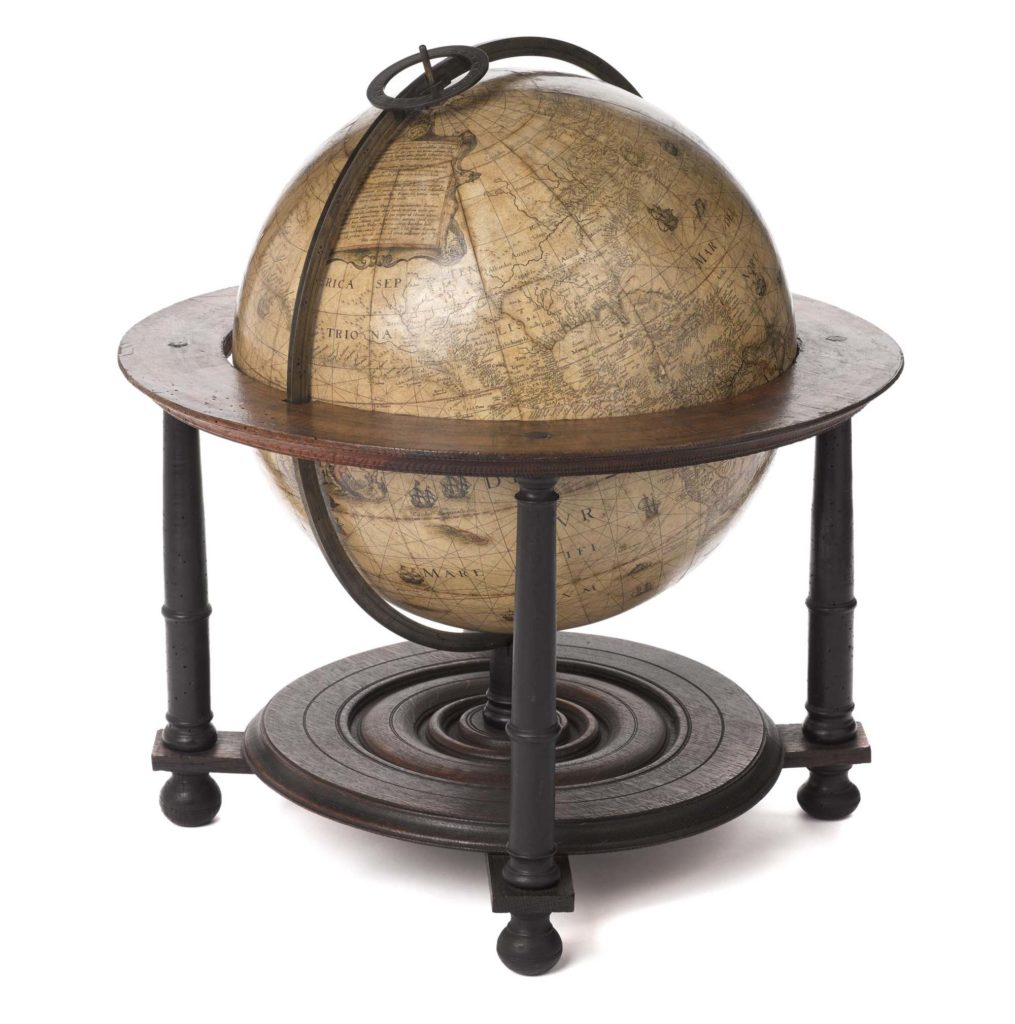 a photo of an old fashioned floor mounted globe