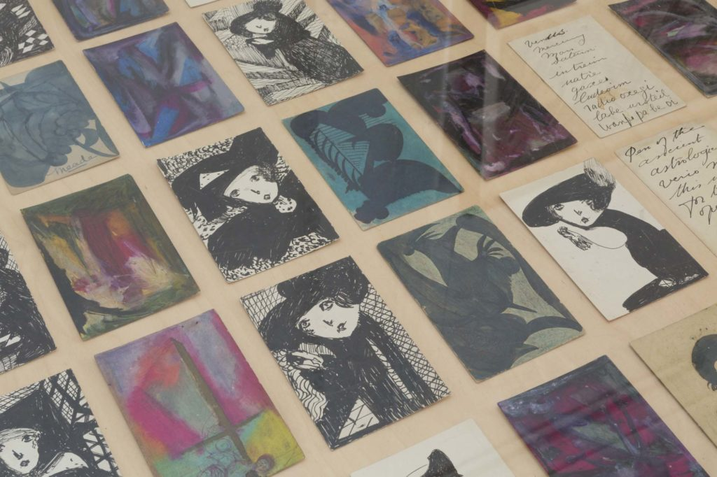 a photo of a series of small postcards in a display case