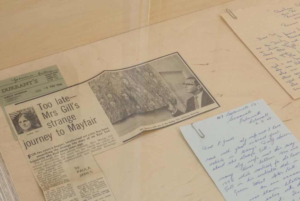 a photo of letters and newspaper clippings in a display case