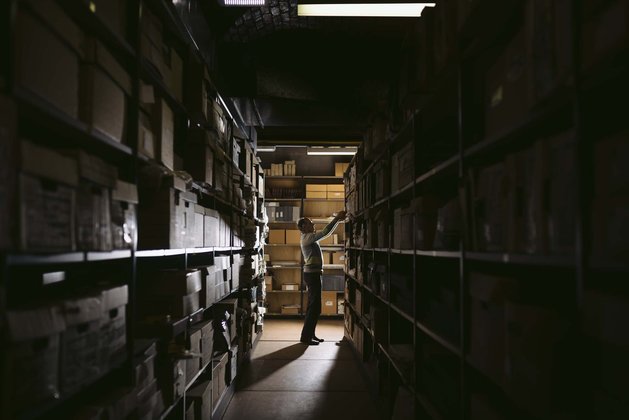 a photo of a store room with rows of racking