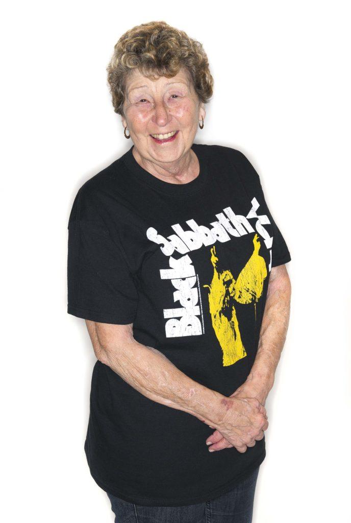 a photo of a mature woman wearing a Black Sabbath T-shirt