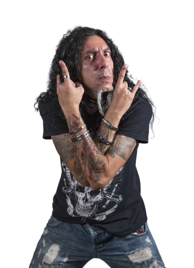 photo of a dude wuth long hair and piercing pulling a heavy metal pose