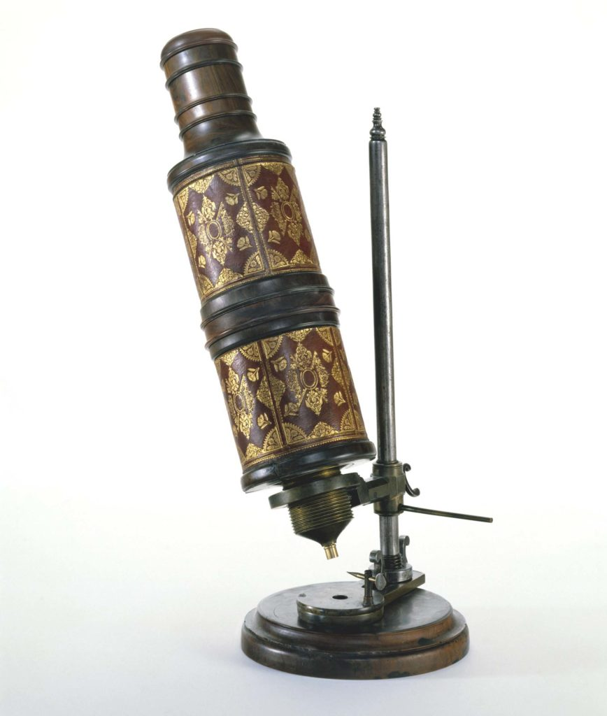 a photo of an old microscope