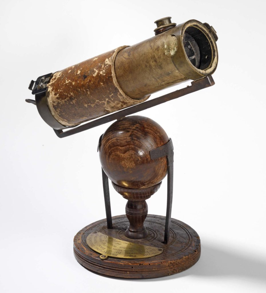 a photo of an old telescope