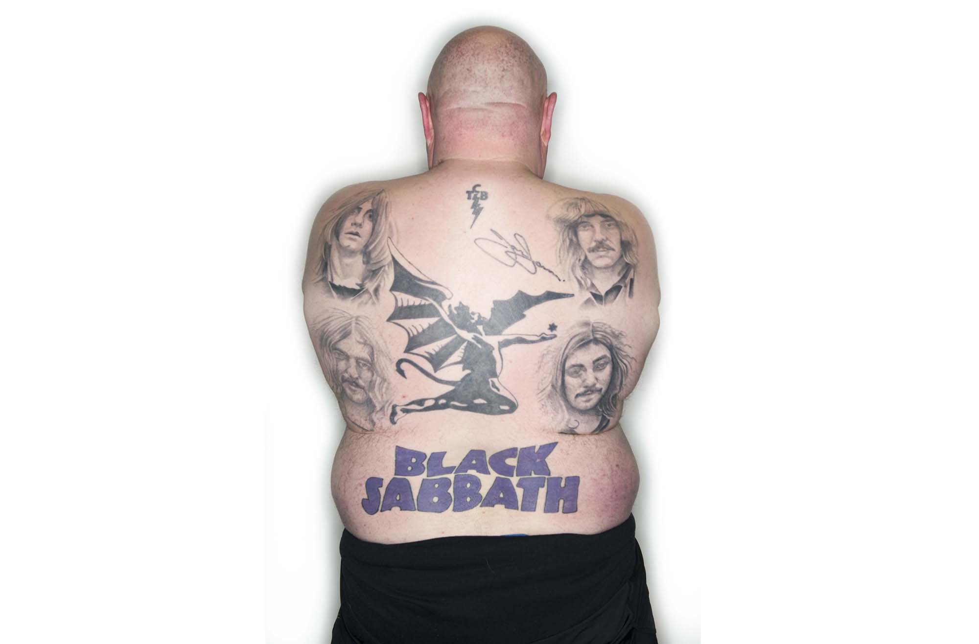 a photo of the back of bald man featuring tattooed portraits of the original members of Black Sabbath