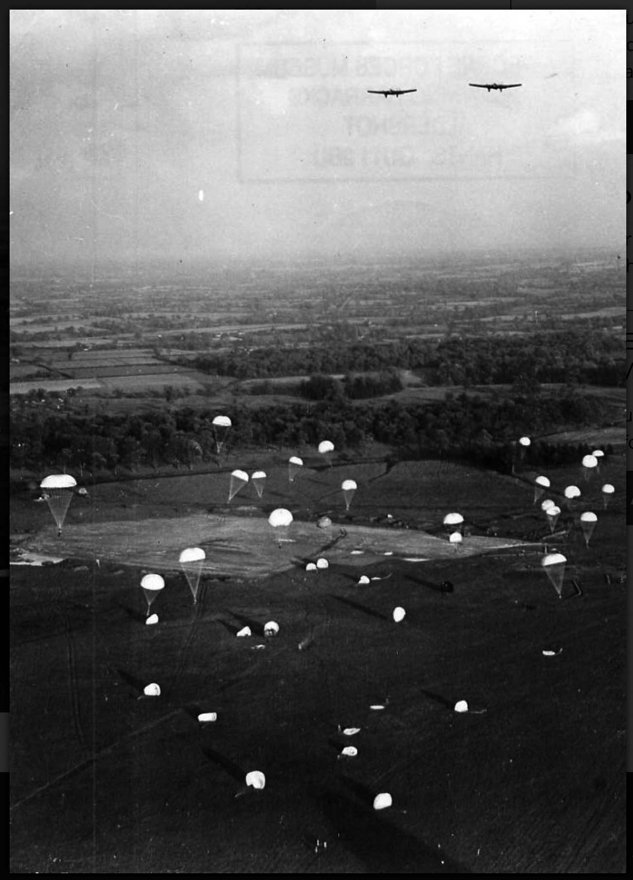 an aerial photo of parachutes floating to the ground